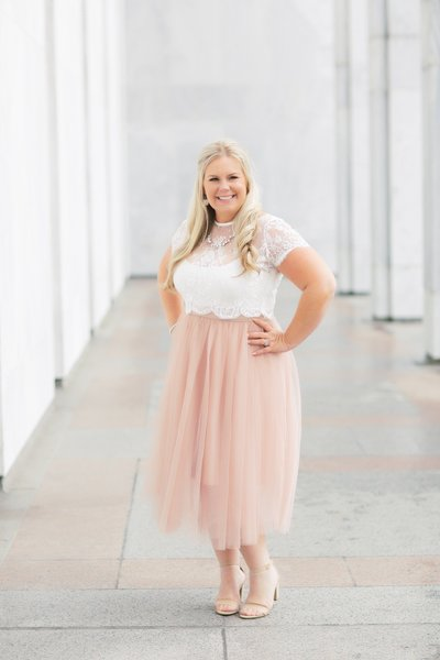 Los Angeles Wedding photographer  Marianne Lucas branding pictures in DC. Wearing a blush pink long tulle skirt with a white lace  shirt.