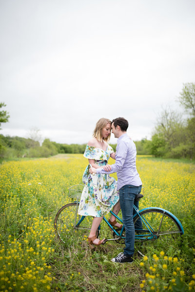 Engagement Couple looking at eachother on bicycle