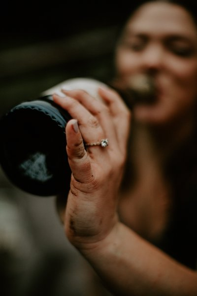 woman drinking out of wine bottle