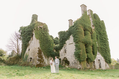 bride and groom standing and holding hands at Menlo Castle in Galway Ireland