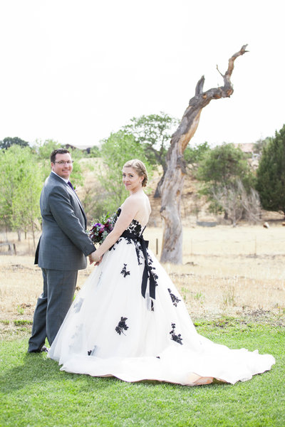 bride and groom pose for their wedding photos at their santa ynez wine country wedding