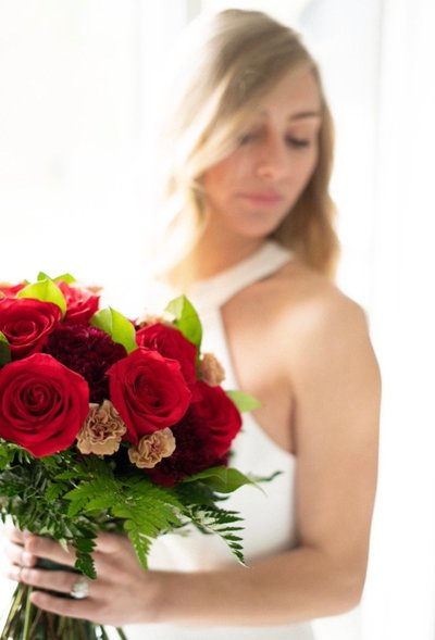 Blonde girl holding bouquet of roses