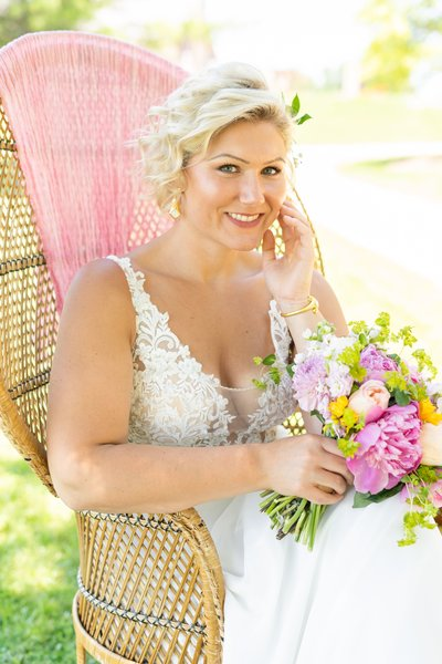 Bride relaxing on her wedding day with bright color palette.