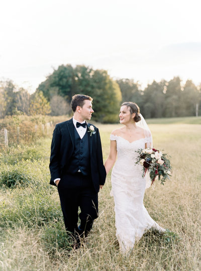 strong mansion wedding portrait in grass field by Natalie Jayne Photography