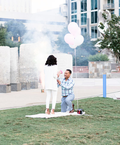 Charlotte wedding photographer shot of epic proposal photo in Romare Bearden Park in uptown charlotte featured on wedding wire