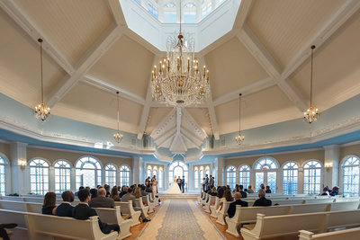Wedding Ceremony Inside a Chapel During with a Grand Chandelier a Walt Disney World Wedding