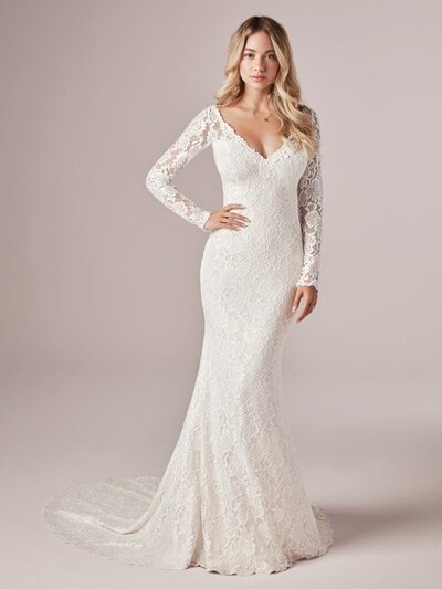 Long Sleeve Sheath Wedding Dress. Lace is classic. Amp up the charm with illusion details and a super sexy neckline. It's easy-breezy in this long-sleeved sheath wedding dress in boho-inspired lace.
