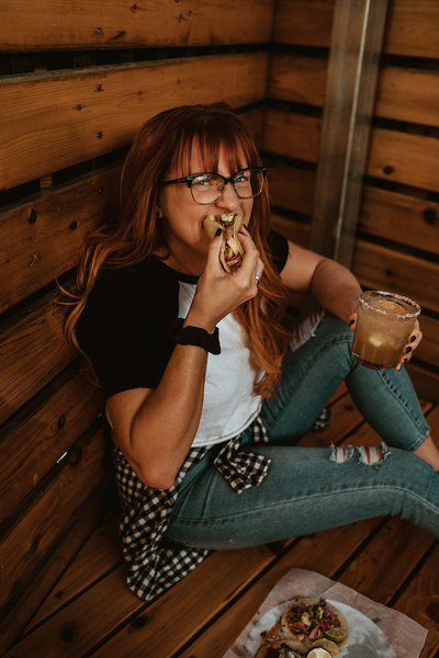 woman eating taco