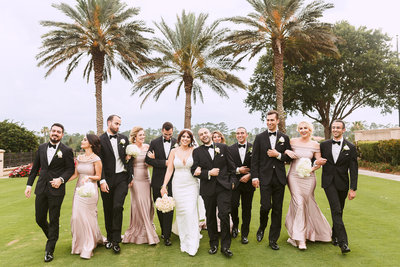 Bridal Party and Bride and Groom Walk Arm in Arm During their Country Club Wedding Photo Shoot