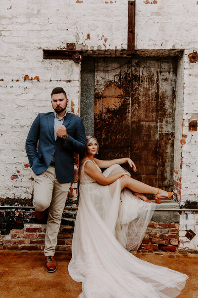 bride and groom kicked back giving sass
