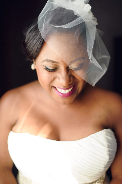 bride smiles as large as she can for