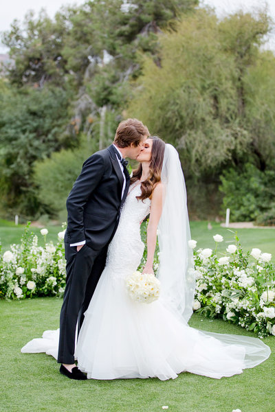 Bride and groom kissing at Paradise Valley Country Club