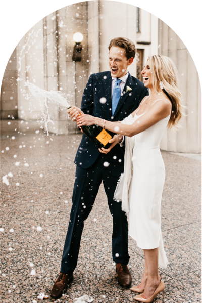 couple opening a champagne bottle