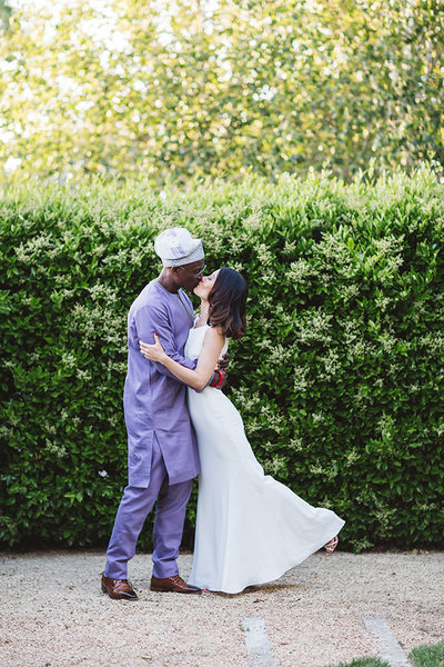 japanese and nigerian wedding couple in winery wedding
