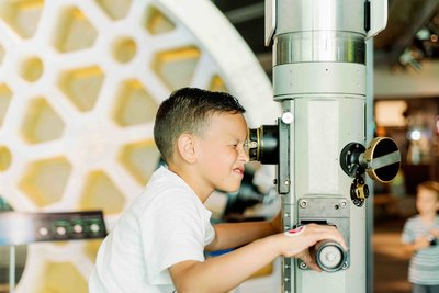 child-looking-through-telescope
