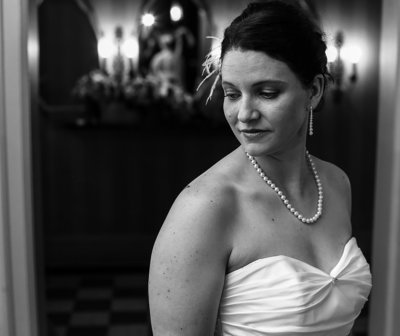Bride stands alone in dressing room before her Warner Theater wedding in Erie, PA