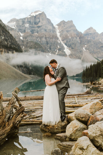 couple standing on a rock at a banff elopement