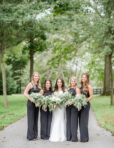 Bride with her bridesmaids on wedding day. black bridesmaid dresses