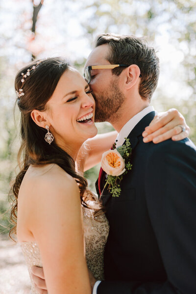 laughing married couple at sunny backyard tennessee wedding