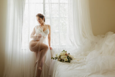 Bride wears lingerie and wraps herself in a veil