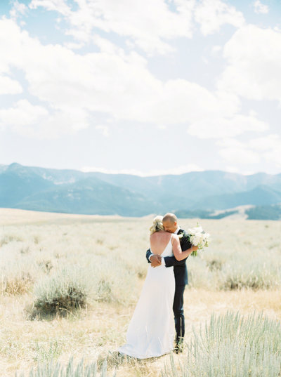 Bride & Groom Embrace on Family Ranch in Red Lodge
