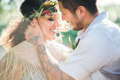 Hawaiian inspired bride and groom with haku lei