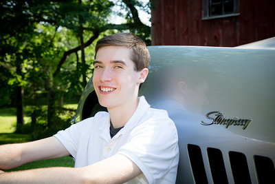 High School senior with stingray corvette