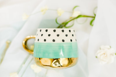 teal gold and polka dot cup with flowers