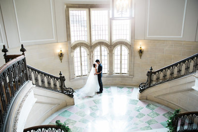 Bride and Groom first look on elegant steps at The Armour House in Lake Forest, Illinois
