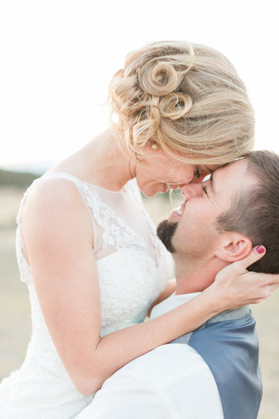 Happy bride and groom kissing