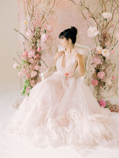 pink-wedding-dress-floral-arch-Stephanie-Brauer