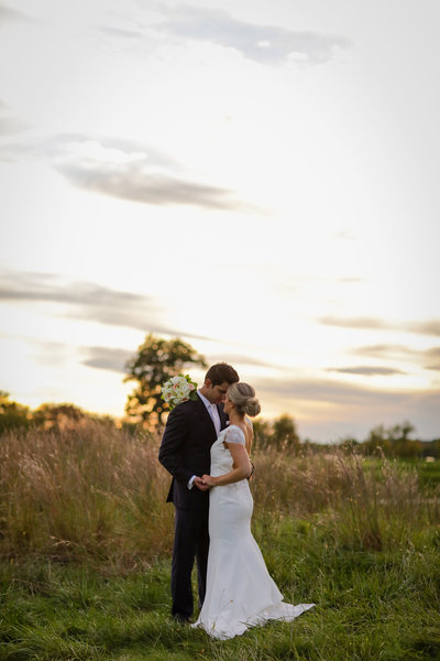 Bride & Groom in wheat field summer wedding