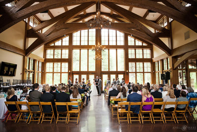 Donovan-Pavilion-Indoor-Wedding-Ceremony-on-a-Rainy-Summer-Day-in-CO