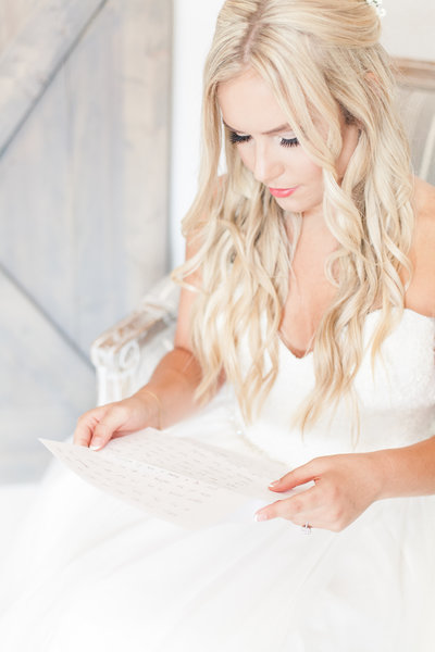 Bride reading a love letter her fiance wrote to her