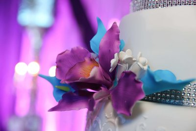 Close up of purple sugar flower on wedding cake. Photo by Ross Photography, Trinidad, W.I..