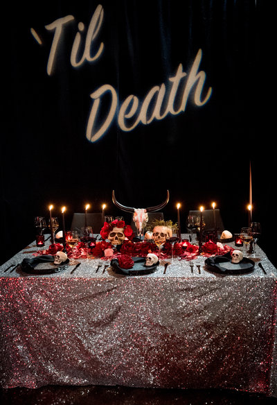 dark and moody, edgy wedding decor in red, silver glitter and black