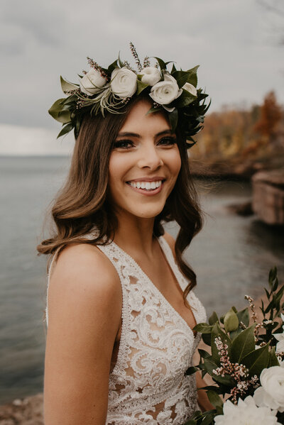 bride wearing wedding dress while holding wedding bouquet