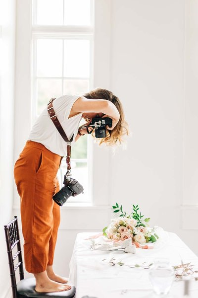 Virginia Wedding Photographer, Cat Deline taking a photograph of a table setting