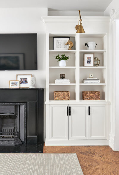 Living room with fire place and open shelving styled with home decor accessories