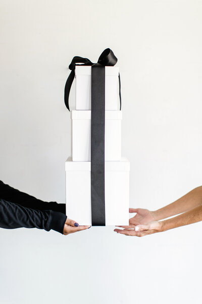 White gift boxes with black ribbon