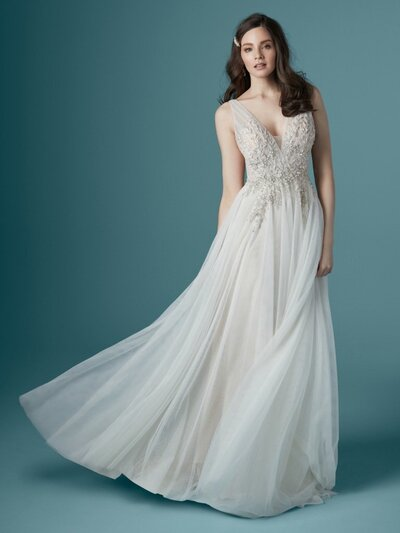 "Romantic A-Line Wedding Dress. What is soft and pretty must also be beautifully tailored. We consider this our ""Grecian glamour with a boho twist"" kind of package—a romantic A-line wedding dress with style and sophistication."