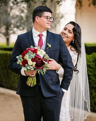romantic couple embrace pasadena city hall wedding photographer