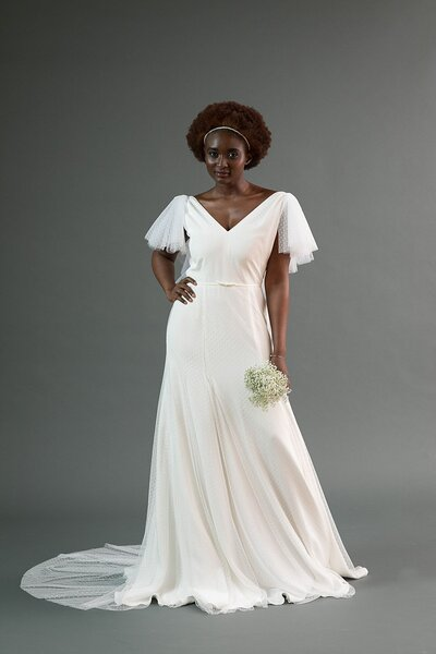 Model wearing the Mai flutter sleeve style from the Edith Elan 2019 bridal collection