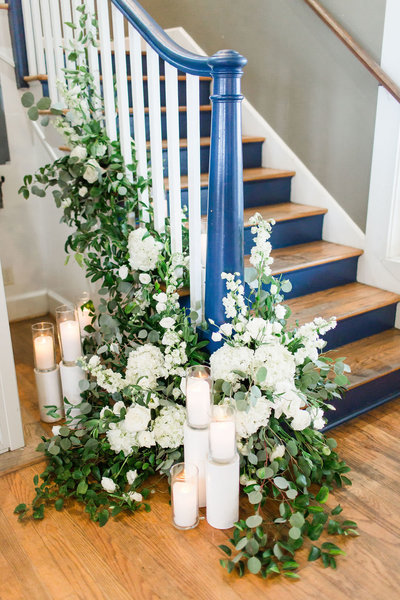Green and White Floral Display to accent a staircase