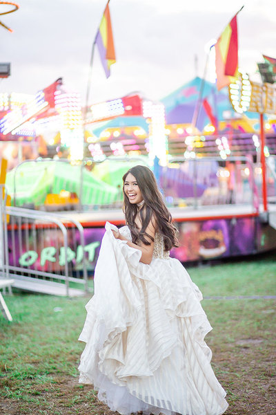 A girl in a gown laughs at the Hardee County Fair, Wauchula, Florida.