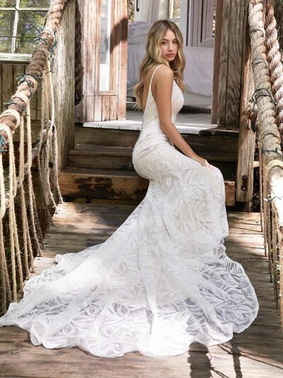 Sequin Mermaid Wedding Dress. Are those feathers? Palm leaves? Paintbrush strokes? Keep your bridal party guessing with this extraordinary mermaid wedding dress in shimmery sequined lace.