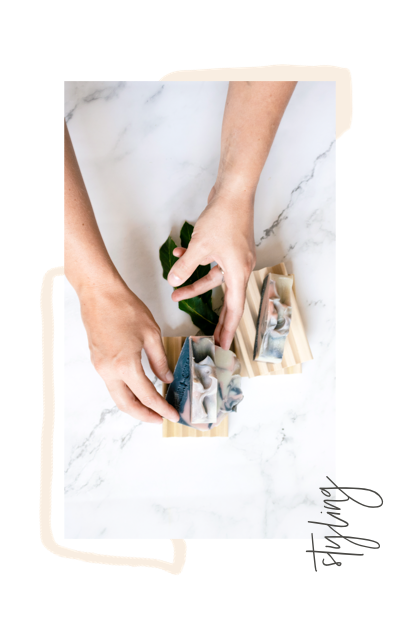 lady's hands arranging soaps for product shoot