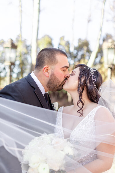Bride and groom kiss at Nanina's in the Park wedding captured by NJ wedding photographer Diana & Korey Photo and Film