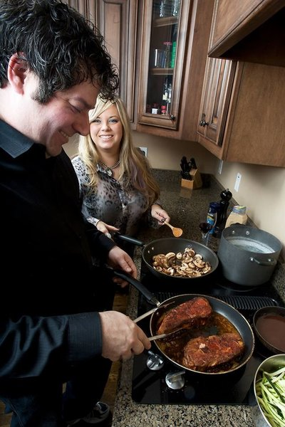 Erica and Chris Rains cooking together - Sarah Bailey Photography