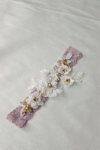 Custom garter dusty mauve with lace applique beading and gold elements 1